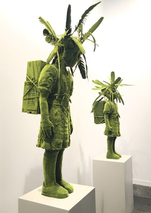 Kim Simonsson. Mossgirl and mossboy with birdhouse (Ceramics, Nylonfibre, feathers).